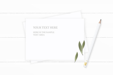 Flat lay top view elegant white composition paper nature leaf and pencil on wooden background