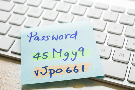 Login password on paper note and keyboard.