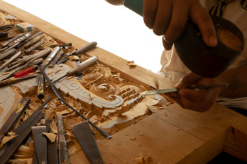 Wood carving in Thailand craftsman.