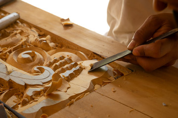 Wood carving in Thailand craftsman. Wall mural