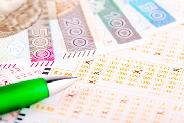 Lottery ticket with a pen and Polish money