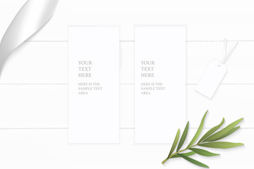 Flat lay top view elegant white composition paper tarragon leaf tag and silver ribbon on wooden background