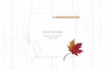 Flat lay top view elegant white composition paper autumn red maple leaf pencil and cardboard tags on wooden background