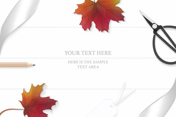 Flat lay top view elegant white composition silver ribbon autumn maple leaf pencil and vintage metal scissors on wooden floor background