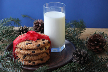 A glass of milk and cookies for Santa. Christmas Eve Concept.