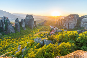 Wall Mural - Landscape with Roussanou Monastery and rock formations at sunset, Meteora, Greece.