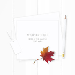Flat lay top view elegant white composition paper tag pencil and autumn maple leaf on wooden background