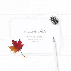 Flat lay top view elegant white composition paper pine cone autumn maple leaf and pencil on wooden background