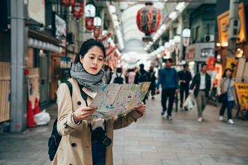 asian tourist walking in the teeming market