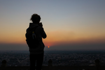 Silhouettes of man taking pictures against the sunset at Nahagarh Fort Jaipur.