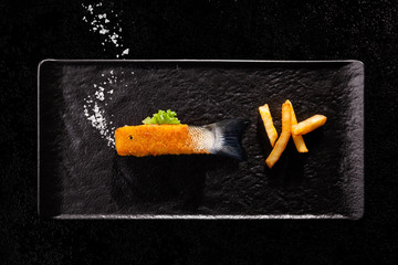 Crispy deep fried fish finger with raw tail and salt as bubbles.