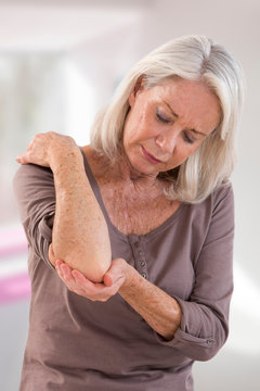 Skincare and Medicine concept: Close up of woman scratching the itch on her elbow ,