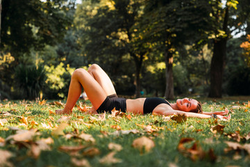 Fit young woman relaxing in a park