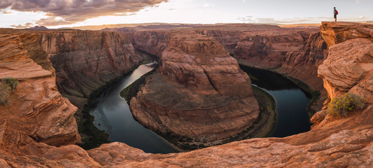 USA, Arizona, Colorado River, Horseshoe Bend, young man standing on viewpoint