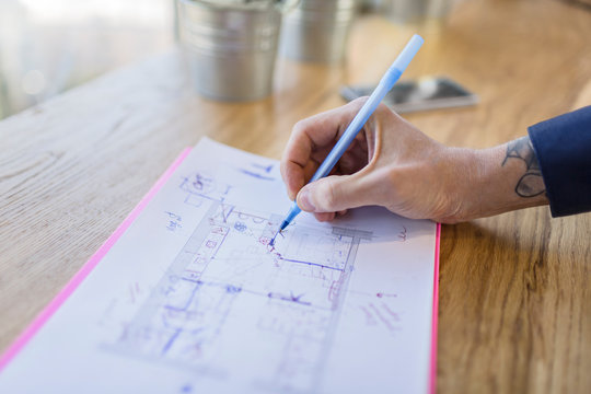 Close-up of architect working on construction plan