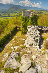 View of ruins of the former castel of Montousse with Pyrenees on bacground, France