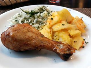 Fotobehang Assortiment European lunch. Cabbage salad, chicken, potato side dish.
