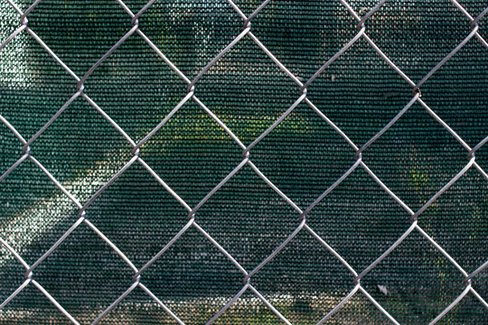 Chain link fence with fabric screen