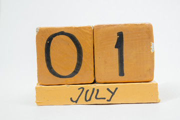 july 1st. Day 1 of month, handmade wood calendar isolated on white background. summer month, day of the year concept