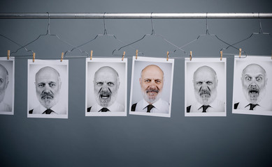 Collection of expressions and portraits hanging in line