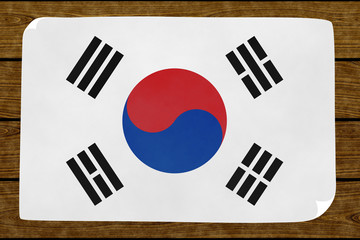 Illustration of a South Koreas´s flag painted on the papier pasted on the woody wall