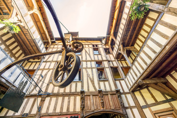Medieval courtyard surrounded by half timbered houses with well in the middle of it, Troyes, France