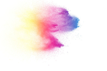 Abstract color powder explosion on white background.Freeze motion of dust splash. Painted Holi in festival.