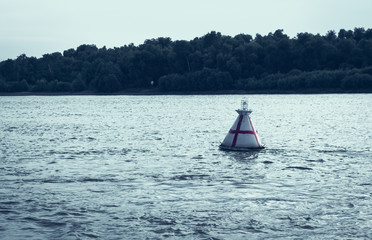 Navigation buoy along the fairway of the river indicates the path for the passage of ships