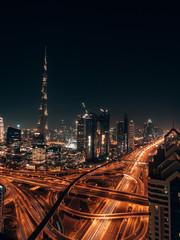 Dubai Skyline at night with a glowing Burj Khalifa