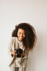Cheerful black woman with camera