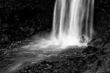 Detail of Gufufoss waterfall in black and white