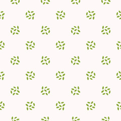 Tiny green leaves polka dots . Hand drawn seamless vector pattern illustration. Simple and elegant trendy garden floral leaf on white background.