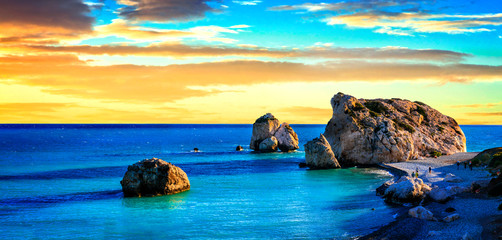 Fotorolgordijn Blauw Best beaches of Cyprus - Petra tou Romiou over sunset