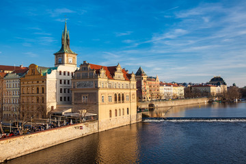 Golden light over the beautiful old town of Prague city during sunset at early spring seen from Charles Bridge