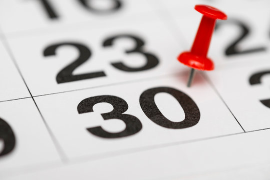 Pin on the date number 30. The thirtieth day of the month is marked with a red thumbtack. Pin on calendar