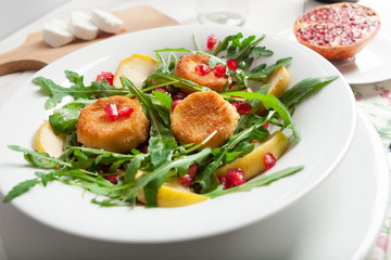 Goat cheese, garden rocket and pomegranate salad.