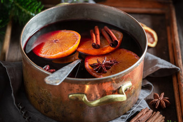 Aromatic and strong mulled red wine on rustic table