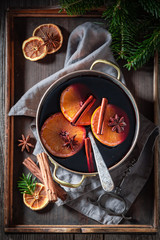 Aromatic and strong mulled red wine with cinnamon and oranges