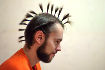a man with a mohawk tails in profile