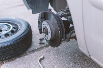 mechanic changing a wheel of a car