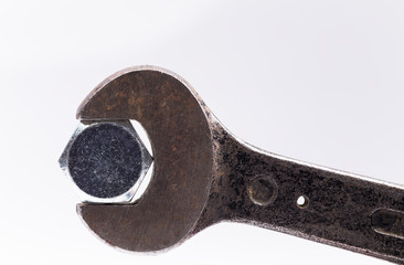 Image shows a construction screw with an old wrench