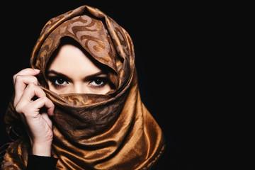 Young Arabian Muslim woman in hijab, studio shot