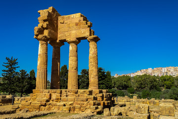 Ruins of Greek Temple of Castor and Pollux with Agrigento in the Background.