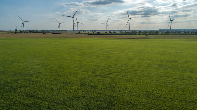 Windmills on Overcast Day and Greenery on Forefront