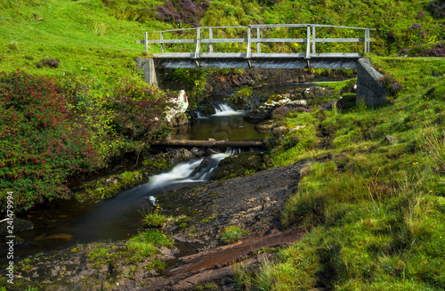 Small Wooden Bridge Over Wild Creek On The Isle Of Skye In