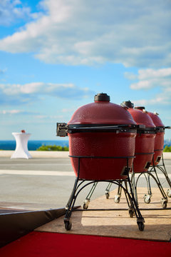 Three kettle barbecue grill with cover on outdoor. Ready for cook.