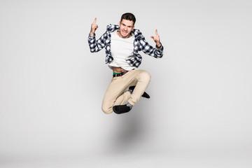 Smiling joyful man jumping isolated on a white background