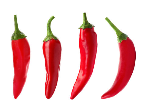Set with fresh red chili peppers on white background