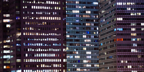 Close-up view of some apartments with lights on in some Manhattan buildings, New York City, United States...