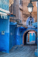 Deurstickers Marokko Alley with arches in Chaouen, the called blue city, a beautiful town in the north of Morocco very visited by tourists from around the world.